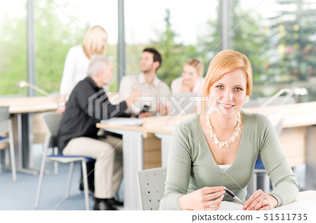 Young business students having meeting - businesswoman in front 51511735