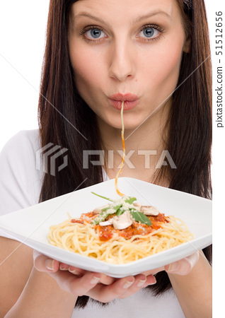 Italian food - portrait of healthy woman eat spaghetti with sauce 51512656