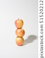 Organic empire apples stacked up balanced on white background 51520212