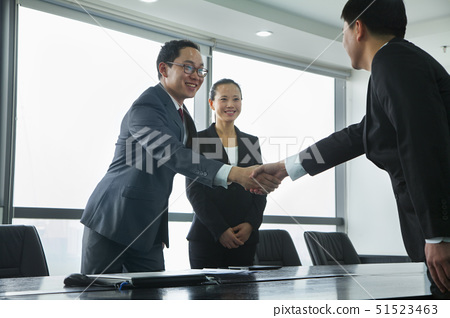 Businessmen Greeting Each Other with a Handshake 51523463