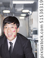 Young Businessman covered in lipstick kisses 51536319