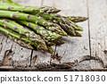 Bunch of fresh raw garden asparagus closeup on 51718030