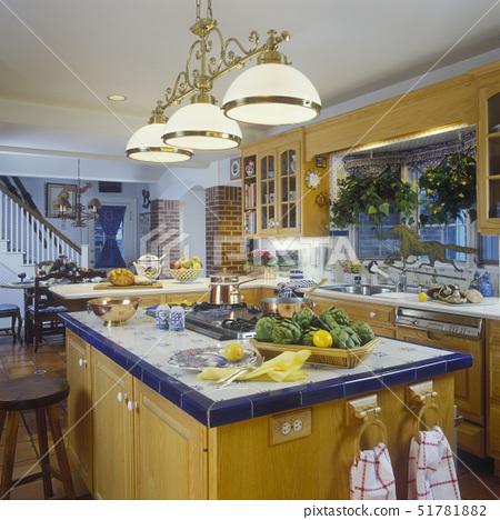 KITCHEN - French country. Island. Blue ceramic tile top, ceramic edges, brass task lighting, bay win 51781882