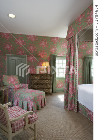 Bedrooms: View of sitting area at foot of bed. A medium green fabric with rose color floral pattern, 51784634