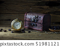 Old pocket watch and Treasure Chest on dark wood 51981121
