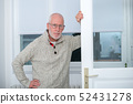 portrait of middle-aged man with beard and glasses 52431278
