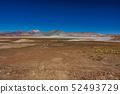 Red stones and Talar salar in Atacama 52493729