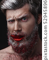 Glamour man with red lips and tongue 52945896