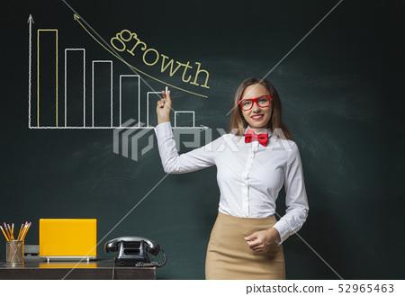Businesswoman Pointing a Blackboard Bar Chart 52965463