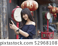 young asian woman enjoy with smart phone  52968108