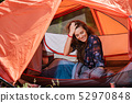 Happy young tourist girl smiling in tent 52970848
