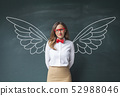 Businesswoman with angel wings 52988046