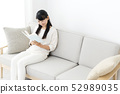 Young woman relax reading 52989035