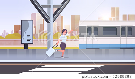 businesswoman running to catch train business woman with luggage on railway station city public 52989898