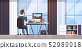 businessman sitting at workplace desk rear view business man using computer while talking on 52989918