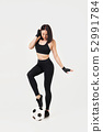 beautiful athletic woman with the ball 52991784