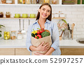 Happy Housewife With Shopping Bag Full Of Vegetables 52997257