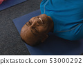 Close-up of senior man exercising in fitness studio 53000292
