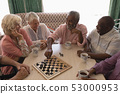 Group of senior people playing chess in living room 53000953