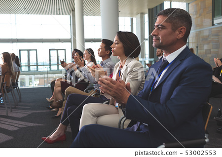 Business people applauding in a business seminar 53002553