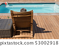 Senior woman relaxing on sun lounger in the backyard of home 53002918