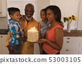 Multi-generation family celebrating birthday at home 53003105