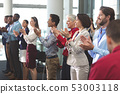 Happy business people applauding in a business seminar 53003118