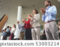 Business people applauding in a business seminar 53003214