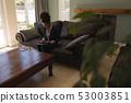 Female real estate agent using digital tablet in living room 53003851