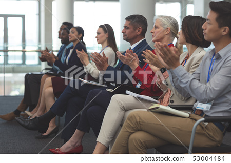 Business people applauding in a business seminar 53004484