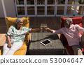Senior couple toasting glasses of champagne in the backyard of home 53004647