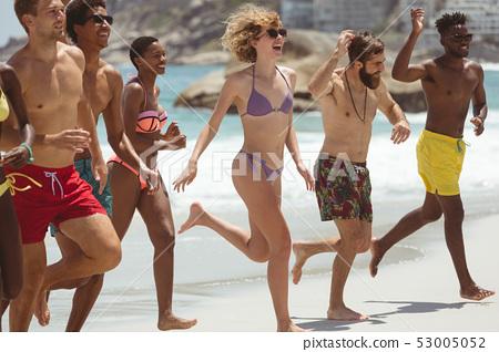 Group of friends enjoying at beach  53005052