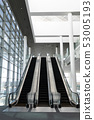 Front view of three modern escalators in a office lobby 53005193