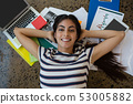 Woman relaxing on documents at office 53005882