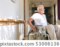 Senior male patient sitting on wheelchair at retirement home 53006136
