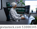 Matured female doctor working on computer in clinic at hospital 53006345