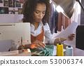 Female fashion designer working in design studio 53006374