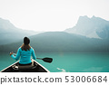 Woman kayaking in lake 53006684