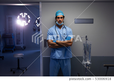 Male surgeon standing outside the operation room at hospital 53006918
