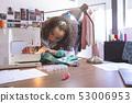 Female fashion designer working with sewing machine 53006953