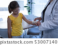 Matured female doctor examining girl hand in clinic 53007140