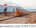 Vessel crew preparing vessel for static tow tanker lifting 53007293
