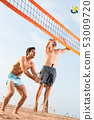 Two friends are playing in volleyball 53009720