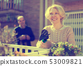 Mature cuople talking at balcon 53009821