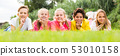 Portrait of five kids who are walking and posing lying 53010158