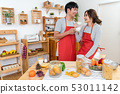 Happy Asian Lover or couple talking and drinking in happiness action in the kitchen room at the modern house, Couple and life style concept. 53011142