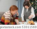 Family quarrel of an elderly mother and adult daughter 53011569