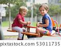 Children having fun at playground 53011735