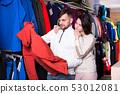 pair choosing ski clothes 53012081