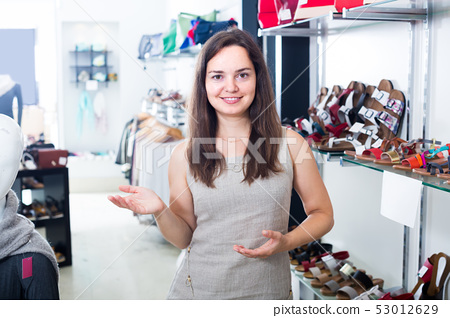 female seller in shoes store. 53012629